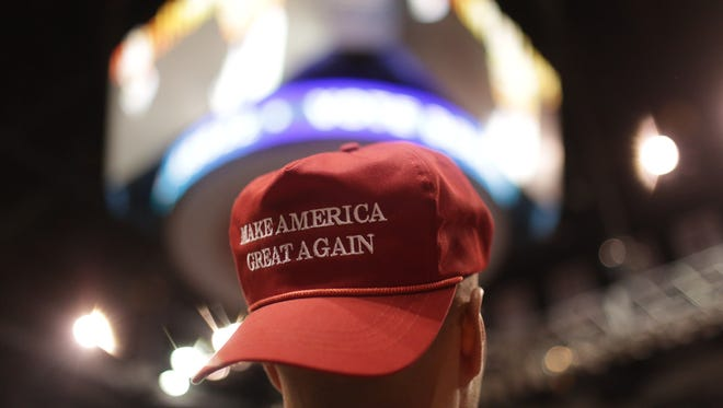 A Trump supporter wears a Make America Great Again hat April 25, 2016.