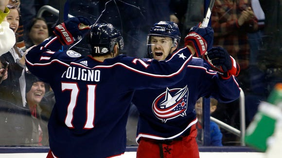 Columbus Blue Jackets' Oliver Bjorkstrand, right, of Denmark, celebrates his goal against the New Jersey Devils with teammate Nick Foligno during the second period of an NHL hockey game, Saturday, Feb. 10, 2018, in Columbus, Ohio.