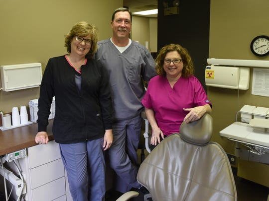 Mark Stewart, center, DDS, with hygienists Ginger O'Reilly, left, and Cindi Barber in one of the exam rooms at the dental practices North 21st Street location.