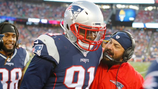 Patriots defensive coordinator Matt Patricia congratulates linebacker Jamie Collins, who scored a touchdown on an interception against the Saints in a preseason game Aug. 11, 2016 in Foxborough, Mass.