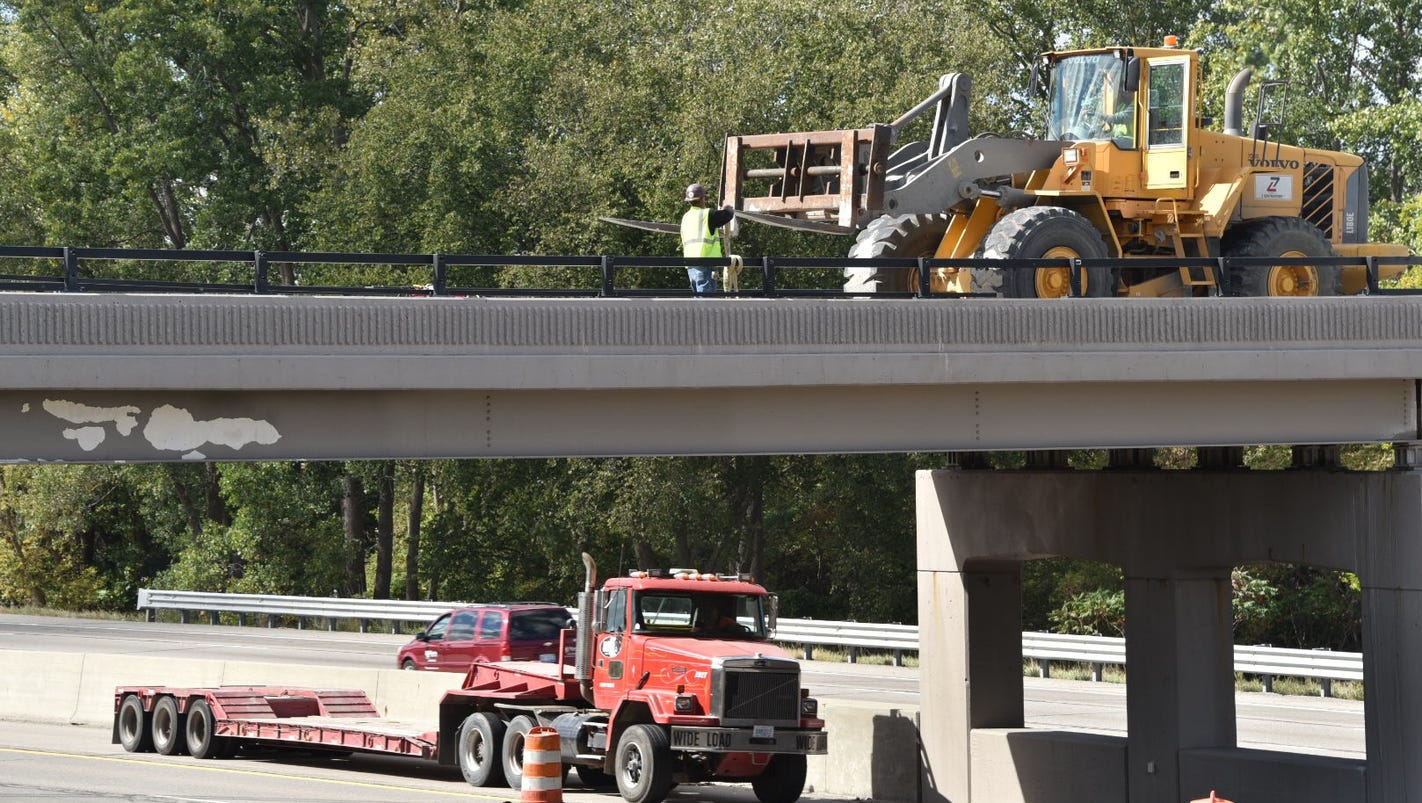 Truck driver who crashed into I-96 bridge ticketed