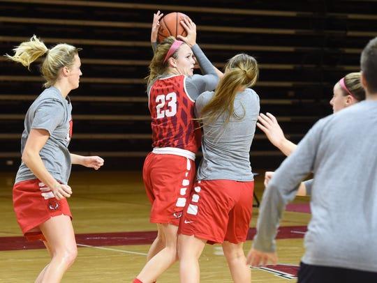 Marist's Rebekah Hand, center, looks for an open teammate