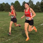 Pinckney girls run to victory in Holly cross country invite
