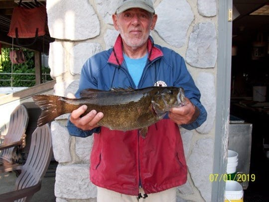 Lou Marcucci shows off a 4 pound seven ounce smallmouth