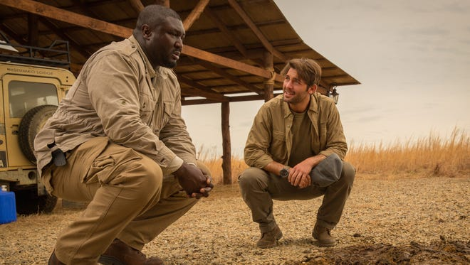"""Abraham (Nonso Anozie) and Oz (James Wolk) hope to solve a rash of unusual and deadly animal behavior in 'Zoo."""""""