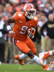 Clemson running back Travis Etienne (9) carries against