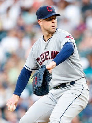 Corey Kluber throws during the fourth inning at Safeco Field.