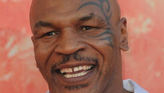 Former boxer Mike Tyson arrives on the red carpet for the iHeartRadio Music Awards held at the Shrine Auditorium in Los Angeles, California.