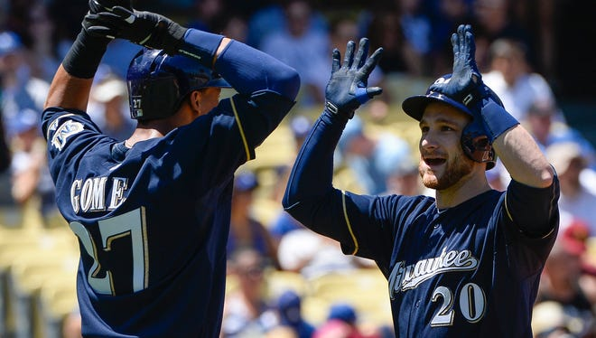 Brewers catcher Jonathan Lucroy (20) celebrates his 2-run homer against the Dodgers with center fielder Carlos Gomez during Sunday's game in Los Angeles.