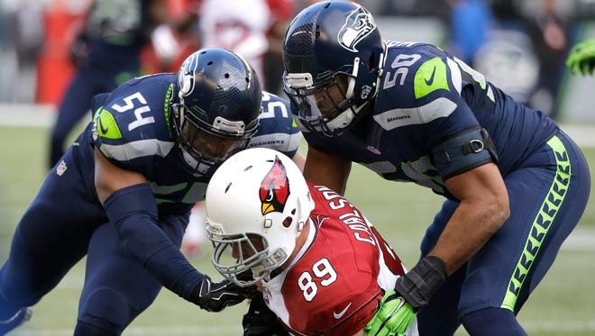 Seahawks LBs Bobby Wagner (54) and K.J. Wright have little trouble covering tight ends.