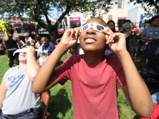 Davon Shiver, 9, of Hackensack looks at the eclipse