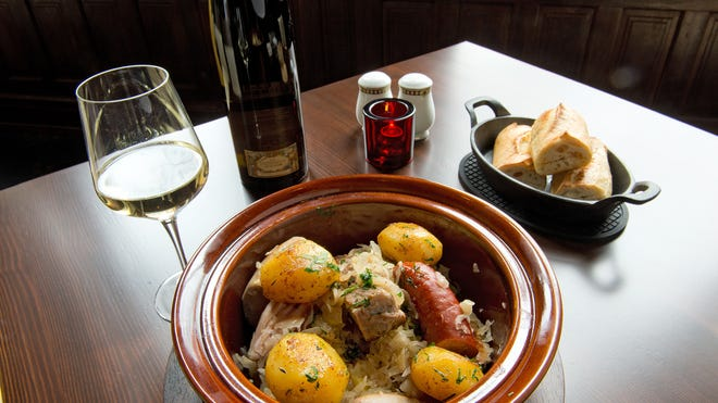 Choucroute garni royale at the Presidents Room is served with fresh bread and a fine white wine.