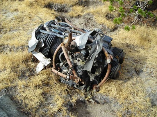 Wreckage of the motor from Steve Fossett's plane is seen on Oct. 3, 2008, near Mammoth Lakes, Calif. Searchers have found what appear to be two large human bones near the crash site of Fossett's plane in California's Sierra Nevada, along with the adventurer's tennis shoes and driver's license, authorities said.