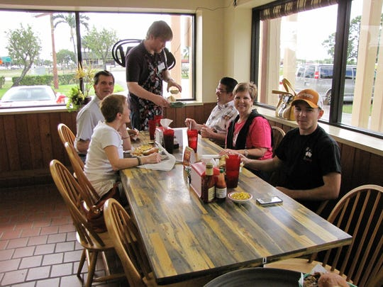 Customers enjoy lunch at Hickory Bar-B-Q in 2013. The Iona restaurant will close, likely for good, later this month.