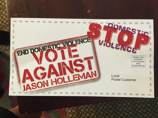 The back-side of a mail piece that targets Jason Holleman.