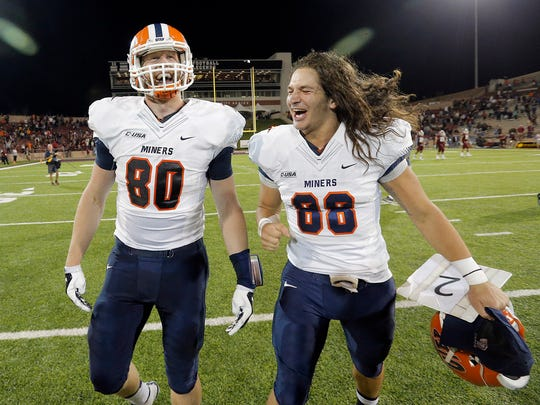UTEP tight end Cedrick Lang celebrates his game-winning, overtime touchdown with fellow tight end Augie Touris Saturday at Aggie Memorial Stadium.