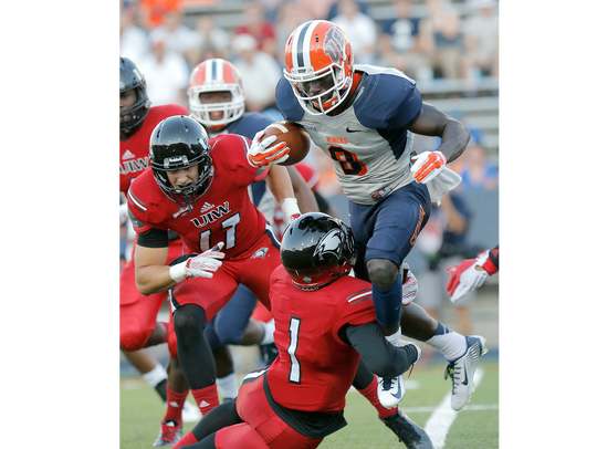 UTEP's Autrey Golden tries to leap over Incarnate Word