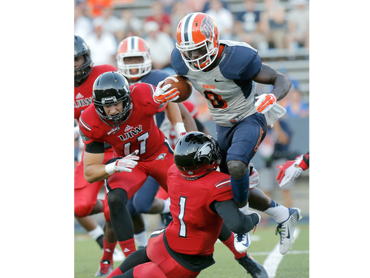 UTEP's Autrey Golden tries to leap over Incarnate Word cornerback Daryl Irby Saturday. Golden, a receiver, might get some reps at tailback this coming week, the coach said.