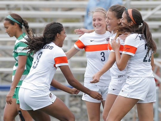 The UTEP soccer team celebrates their second-half goal by midfielder Bri Thomas, second from right, during their match against Marshall Sunday at University Field.