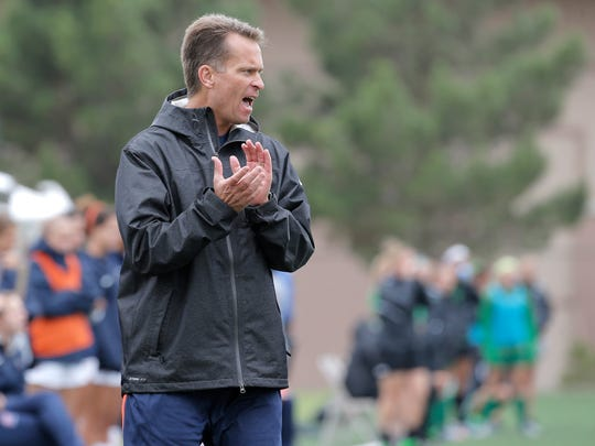 UTEP head soccer coach Kevin Cross shouts instructions from the sideline during the MIners' match against Marshall Sunday.