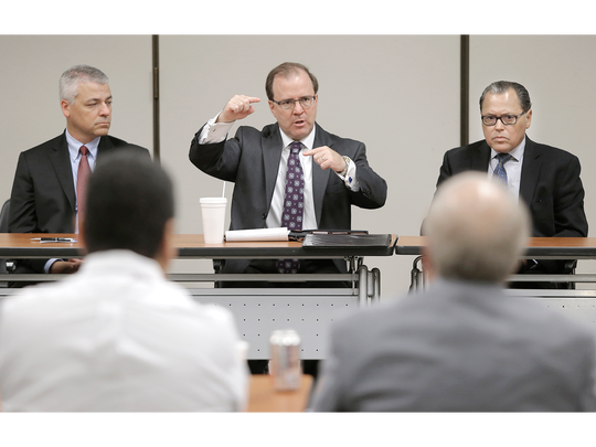 Texas Health and Human Services Commission Executive Commissioner Chris Traylor, flanked by state Sen. Jose Rodriguez, right, and interim Commissioner Kirk Cole, left, hold a roundtable discussion on health at the Greater El Paso Chamber of Commerce.