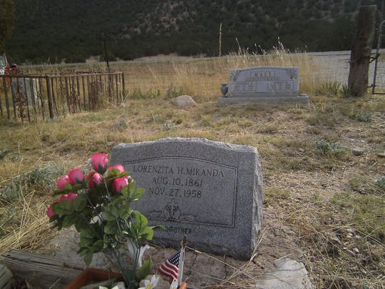 The grave of Lorenzita Miranda lies in front of that of Ramon Maes. Lorenzita knew Billy the Kid; Maes placed the first cross above Lincoln.