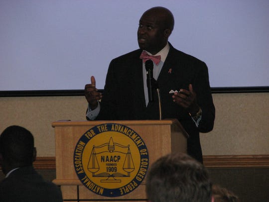 The Rev. Charles White Jr. speaks at the NAACP Freedom