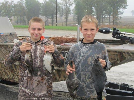 Todd Berning 13, Columbia, left and Logan Smith 12,