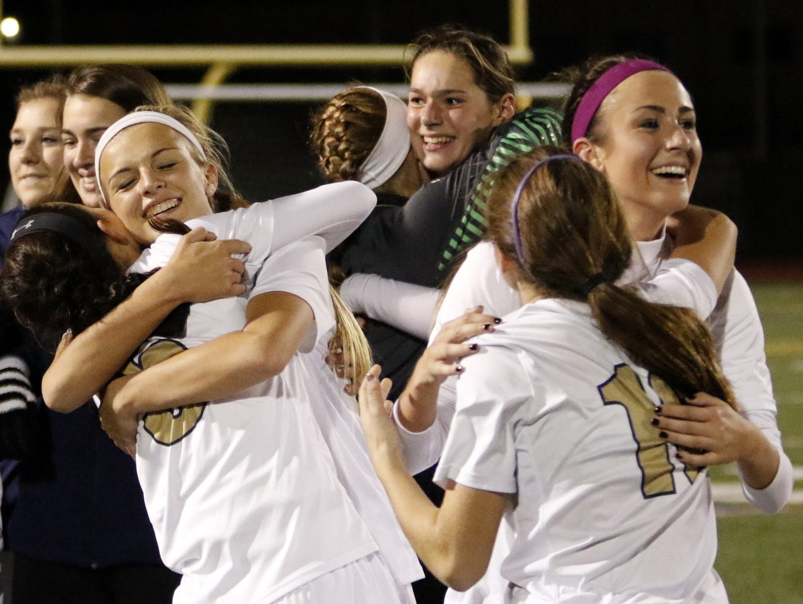 Notre Dame players celebrate their Class C quarterfinal win over Sauquoit Valley.