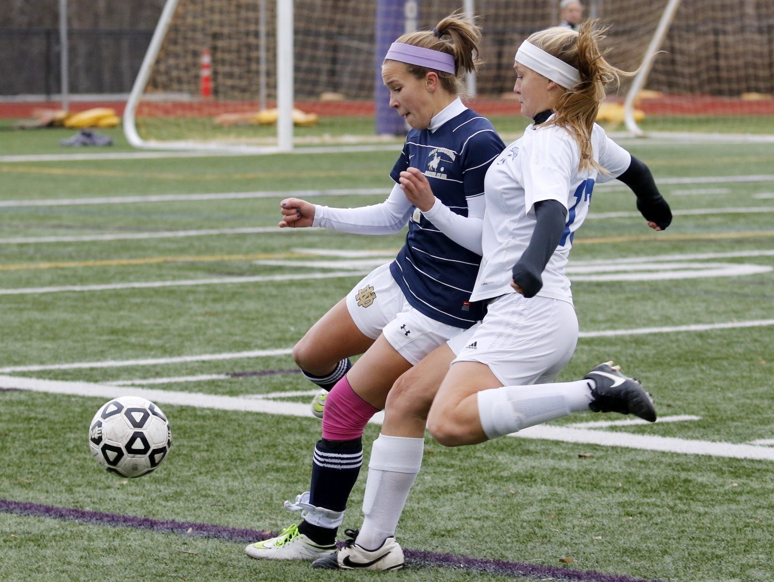 Notre Dame's Emma Booth fights for possession of the ball with Schohaire's Jaida Truesdell during Saturday's Class C state semifinal at Cortland High School.