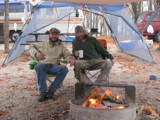 Brothers Jeff Mahan, left, Bolivar, and Phillip Mahan, Pleasant Hope, wait out the rain Monday while deer hunting. The brothers have been deer hunting together for more than 30 years.