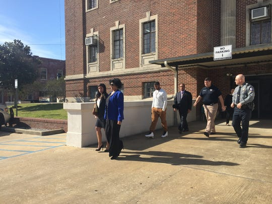 Members of the Greenhouse family, including Cheryl (front left) and Norris Sr. (rear left) leave the Avoyelles Parish Courthouse with an escort after a Tuesday hearing. Judge William Bennett ruled that Avoyelles Sheriff Doug Anderson must accept a property bond posted by Cheryl and Norris Greenhouse for the release of their son, Norris Greenhouse Jr., who faces charges of second-degree murder and attempted second-degree murder.