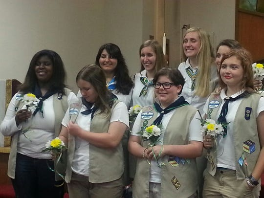 Senior Girl Scouts and Life Scouts pose at the Girl Scout Troop 424 End of the Year Award and Adult Bridging Ceremony.