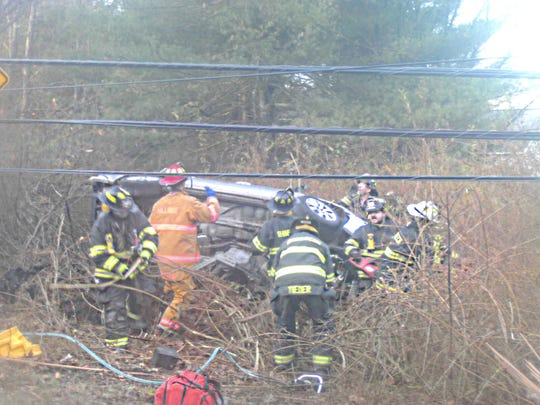 Firefighters at the scene of a one-car crash in Rhinebeck on Friday morning