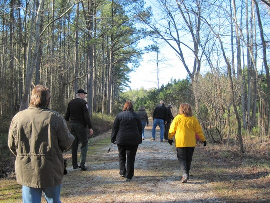A ranger leads a First Day Hike at Janes Island State