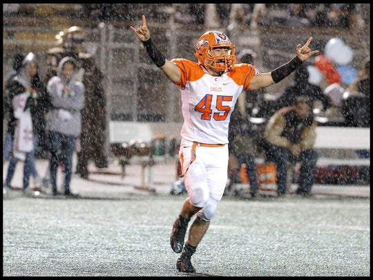 Canutillo linebacker Josh Arrellano celebrates after the Eagles got a turnover against Austin in 2015 at Austin High School. The game was ended early because of rain which gave Canutillo the win.