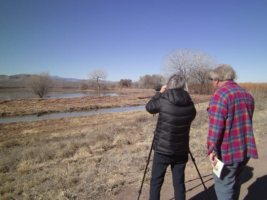 Kathy sets up her tripod to better observe and image waterfowl as Jim, LC Bird Club president, keeps all in sight.