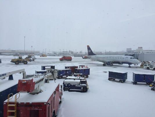 635890590839652153-snow-airport.jpg