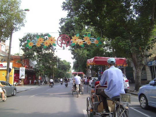 In a cyclo, you're up close and personal with Hanoi's manic traffic.