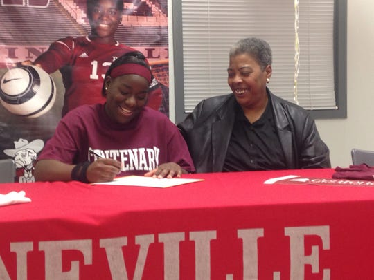 Pineville soccer player Taylor Morgan (left) signs with Centenary Thursday.
