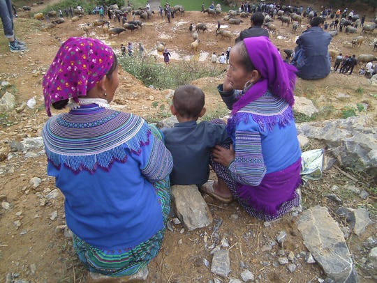 Live animal market:  Flower Hmong villagers watch the