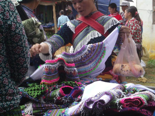 Embroidered crafts are popular market items.
