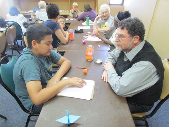 Participants are seen at a peace camp held Wednesday at Munson Senior Center.