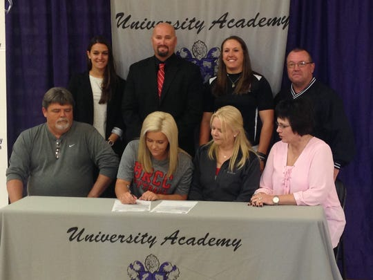 University Academy pitcher Lauren Rachel  (bottom, second from left) signs with Baton Rouge Community College Monday.