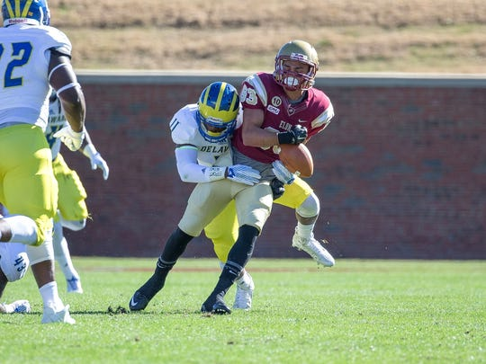 Anthony Jackson, knocking the ball loose from an Elon receiver last year, is among the returning starters at linebacker.