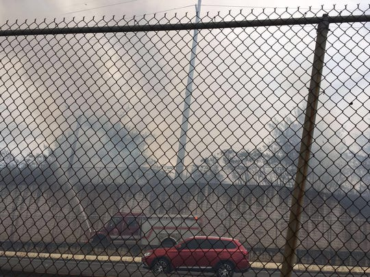 Smoke rise from a grass fire off of Bello Road near the Route 16 airport overpass around 11:30 a.m. Thursday, April 14.