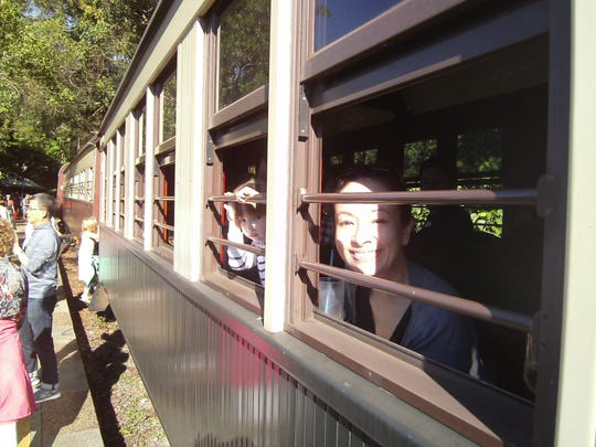 """Riding the Kuranda Scenic Railway is the perfect family outing, say Charlotte, Yvonne's Queensland """"mate"""" (friend) and her daughter Olivia."""