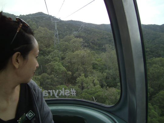 Charlotte, Yvonne's Queensland friend, enjoys views of the rainforest below their cable car.