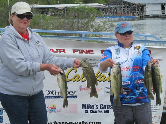 Lisa Opfer, right, took first place in the Bass 'n Gals tournament by weighing in a total of 15.3 pounds of bass. Pam Dugan, left, was her boating partner.