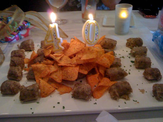 """Michele Ezell of Tsunami's guilty food pleasure is boudin and chips, preferably together, as they were for her 40th birthday """"cake."""""""